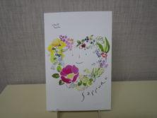 佐々木小世里さん札幌の花のリース柄のポストカードの画像